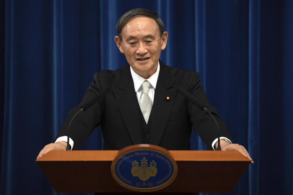 FILE - In this Sept. 16, 2020, file photo, Japan's new Prime Minister Yoshihide Suga speaks during a press conference at the prime minister's official residence in Tokyo, Japan. Japan's new Prime Minister Suga heads to Vietnam and Indonesia on Sunday, Oct. 18, 2020, on his first overseas foray since taking over from his former boss Shinzo Abe last month. (Carl Court/Pool Photo via AP, File)