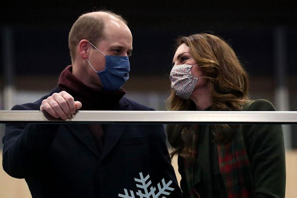 <p>The couple couldn't help but look lovingly at each other as they stood on the balcony at London Euston Station on December 6 before embarking on a three day tour aboard the royal train, visiting members of the British community who have come together during the Coronavirus pandemic. </p>