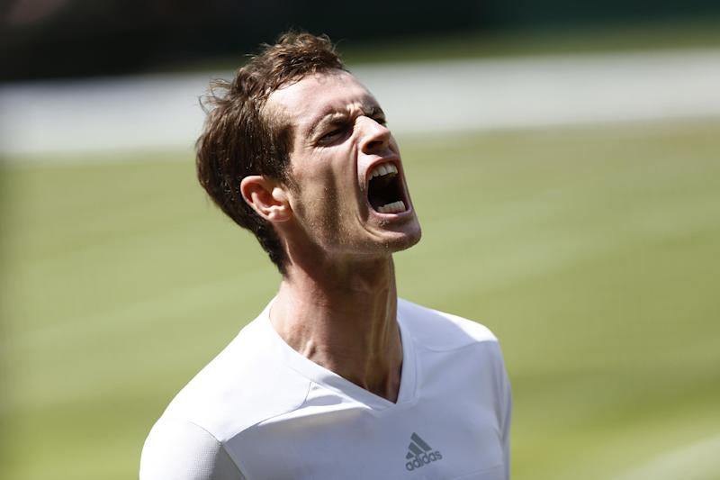 Britain's Andy Murray screams during his men's quarter-final match against Bulgaria's Grigor Dimitrov on day nine of the Wimbledon Championships at The All England Tennis Club in southwest London, on July 2, 2014. Dimitrov won 6-1, 7-6 (7/4), 6-2