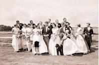 <p>The entire wedding party assembled for a photo on the farm.</p>
