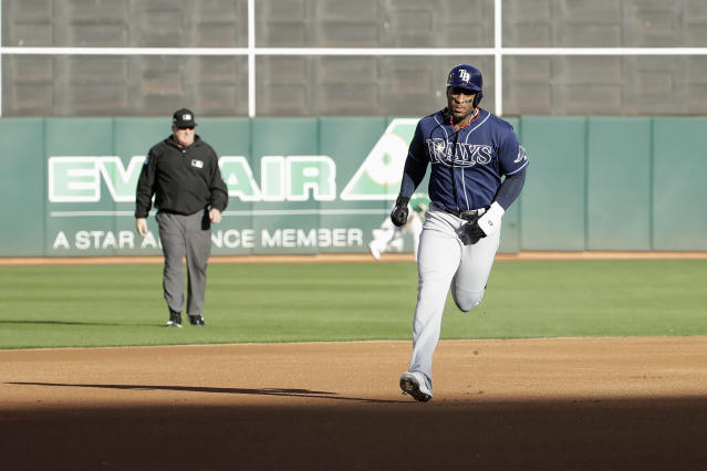 Tampa Bay Rays' Yandy Diaz rounds the bases after hitting a solo home run against the Oakland Athletics during the first inning of an American League wild-card baseball game in Oakland, Calif., Wednesday, Oct. 2, 2019. (AP Photo/Jeff Chiu)
