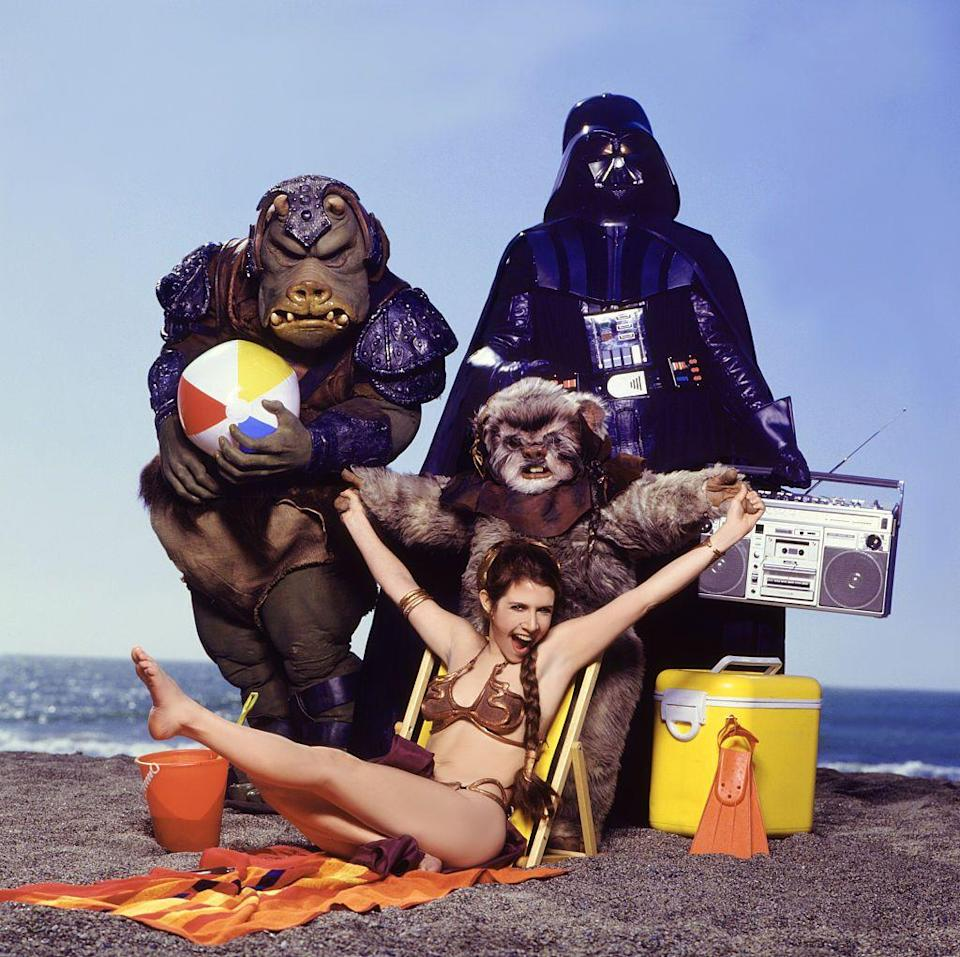 <p>To promote the third installment of <em>Star Wars</em>, Carrie donned a metal bikini and posed for the cover of <em>Rolling Stone</em> magazine, along with a few of her costars.</p>