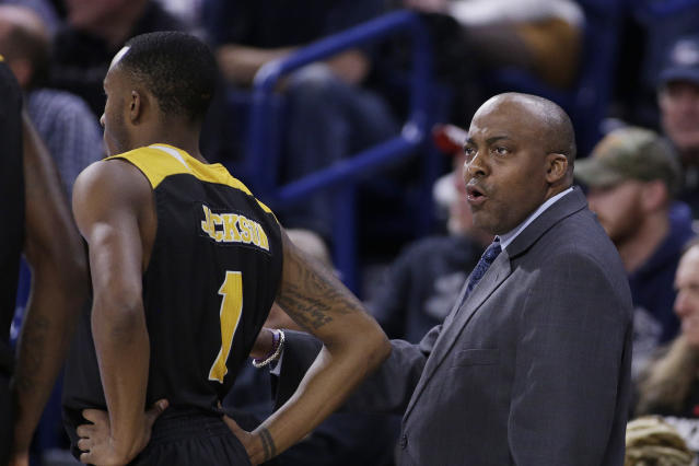 Arkansas-Pine Bluff coach George Ivory, right, speaks with guard Zavian Jackson (1) and other players on his team during the first half of an NCAA college basketball game against Gonzaga in Spokane, Wash., Saturday, Nov. 9, 2019. (AP Photo/Young Kwak)