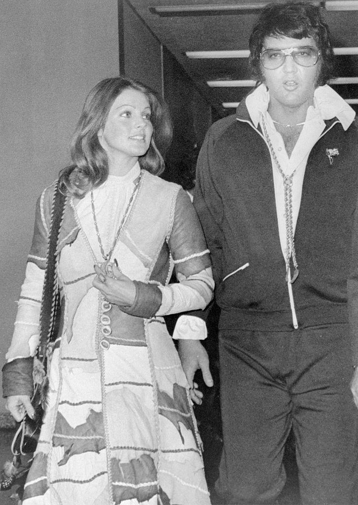 """<p>Elvis and Priscilla separated on February 23, 1972 and finalized their divorce on October 9, 1973, after reaching a shared custody plan for their daughter, Lisa Marie. The proceedings took a year to finalize, after Priscilla filed for divorce after having an affair with her Karate instructor. """"I did not divorce him because I didn't love him. He was the love of my life, but I had to find out about the world,"""" Priscilla told <a href=""""https://www.etonline.com/news/203022_priscilla_presley_opens_up_about_spending_teenage_years_with_elvis_says_he_never_saw_her_without_make_up"""" rel=""""nofollow noopener"""" target=""""_blank"""" data-ylk=""""slk:Entertainment Tonight"""" class=""""link rapid-noclick-resp"""">Entertainment Tonight</a> in 2016.</p>"""