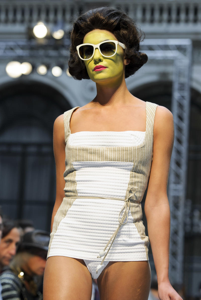 A model wears a design from the Vivienne Westwood Red Label Spring/Summer 2013 collection during London Fashion Week, Sunday, Sept. 16, 2012. (AP Photo/Jonathan Short)