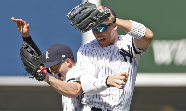 CORRECTS TAYLOR TO LEFT - New York Yankees second baseman Tyler Wade, left, celebrates with right fielder Aaron Judge after the Yankees defeated the Chicago White Sox 4-0 in a baseball game, Saturday, April 13, 2019, in New York. (AP Photo/Kathy Willens)