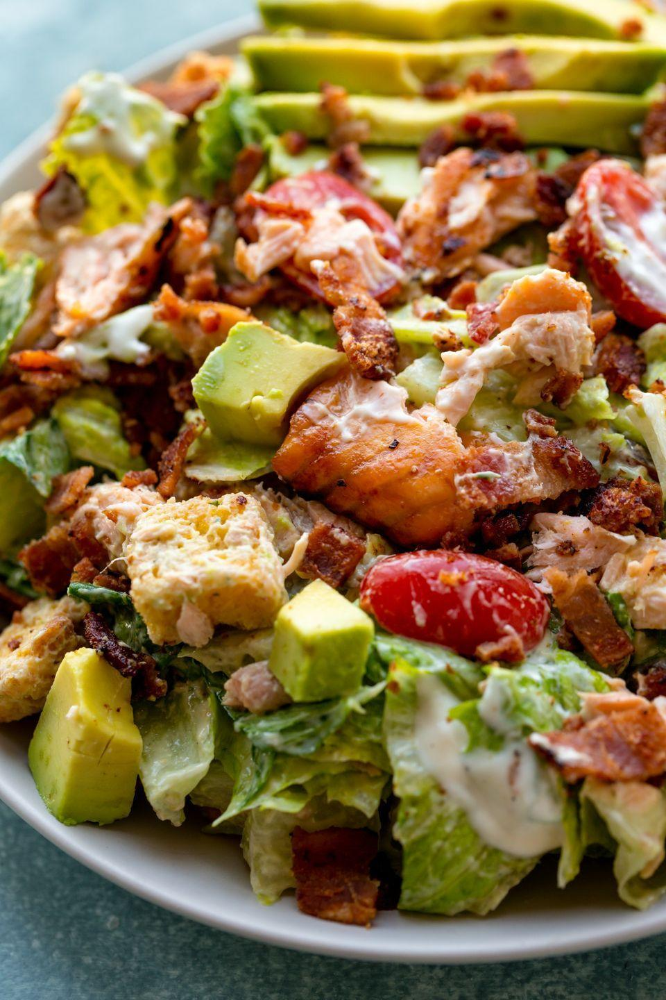 "<p>A salad so flavorful and satisfying you'll forget it all started with lettuce. The combination of salmon, bacon, and avocado is unbelievable and the homemade creamy dressing completes the whole dish!</p><p>Get the recipe from <a href=""https://www.delish.com/cooking/recipe-ideas/recipes/a52792/blt-salmon-salad-recipe/"" rel=""nofollow noopener"" target=""_blank"" data-ylk=""slk:Delish"" class=""link rapid-noclick-resp"">Delish</a>.</p>"