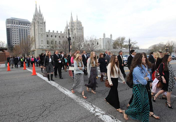 People walk pass the Salt Lake Temple on the way to the Conference Center during opening session of the two-day Mormon church conference Saturday, April 5, 2014, in Salt Lake City. More than 100,000 Latter-day Saints are expected in Salt Lake City this weekend for the church's biannual general conference. Leaders of The Church of Jesus Christ of Latter-day Saints give carefully crafted speeches aimed at providing members with guidance and inspiration in five sessions that span Saturday and Sunday. (AP Photo/Rick Bowmer)