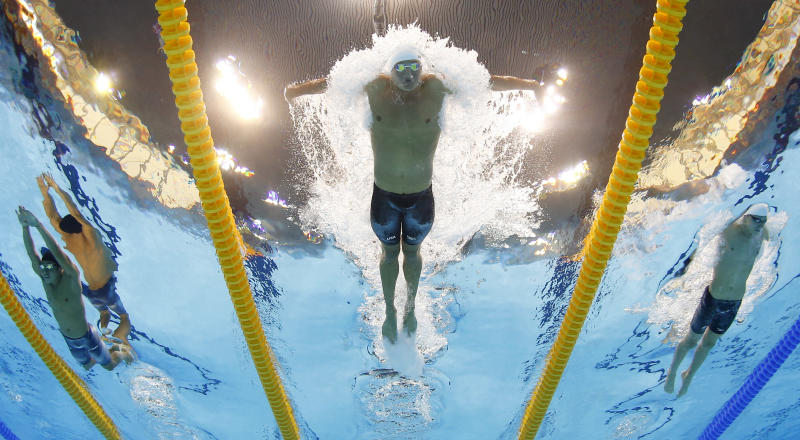 USA's Ryan Lochte competes in a men's 400-meter individual medley at the Aquatics Centre in the Olympic Park during the 2012 Summer Olympics in London, Saturday, July 28, 2012. (AP Photo/David J. Phillip)