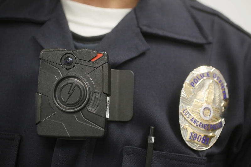 A Los Angeles Police officer wears body camera during a 2014 police presentation. (Photo: Damian Dovarganes/AP)