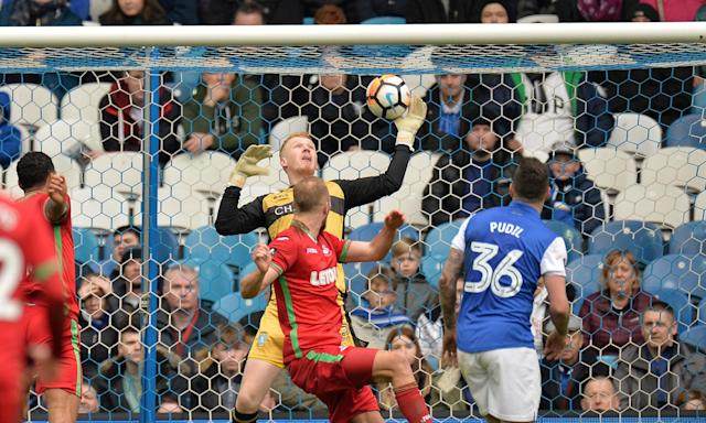 Sheffield Wednesday's Cameron Dawson saves a shot from Swansea City's Mike van der Hoorn during the goalless FA Cup tie at Hillsborough.