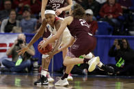 Stanford's Maya Dodson, left, and Missouri State's Mya Bhinhar (23) battle for a loose ball during the first half of a regional semifinal game in the NCAA women's college basketball tournament, Saturday, March 30, 2019, in Chicago. (AP Photo/Nam Y. Huh)