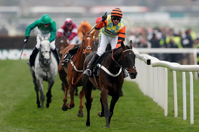 Horse Racing - Grand National Festival - Aintree Racecourse, Liverpool, Britain - April 12, 2018 Nico de Boinville celebrates on Might Bite as he wins the 14:50 Betway Bowl Chase Action Images via Reuters/Matthew Childs