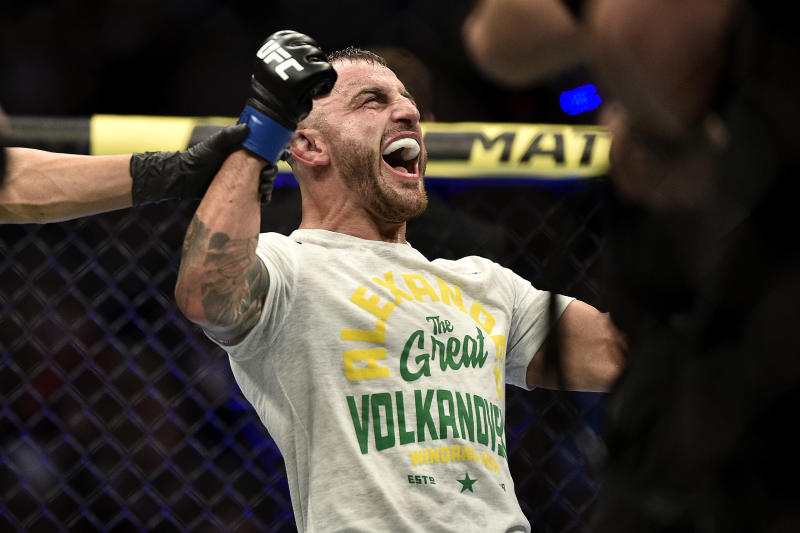 LAS VEGAS, NEVADA - DECEMBER 14: Alexander Volkanovski of Australia celebrates his win in the octagon during the UFC 245 event at T-Mobile Arena on December 14, 2019 in Las Vegas, Nevada. (Photo by Chris Unger/Zuffa LLC)