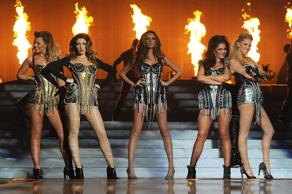 LONDON, ENGLAND - MARCH 01:  Kimberley Walsh, Nicola Roberts, Nadine Coyle, Cheryl Cole and Sarah Harding of Girls Aloud perform on their 'Ten - The Hits Tour' at The O2 Arena on March 1, 2013 in London, England.  (Photo by Dave J Hogan/Getty Images)