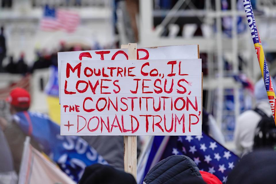 """A sign referencing Jesus is held aloft during a """"Stop the Steal"""" rally in support of President Donald Trump in Washington, D.C., on Jan. 6. (Photo: John Nacion/STAR MAX/IPx)"""