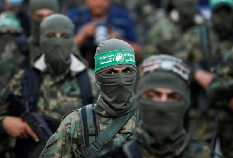 Palestinian Hamas militants take part in an anti-Israel rally in Gaza City