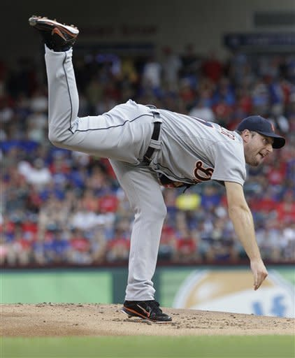 Detroit Tigers starting pitcher Max Scherzer throws during the fist inning of a baseball game against the Texas Rangers, Friday, Aug. 10, 2012, in Arlington, Texas. (AP Photo/LM Otero)