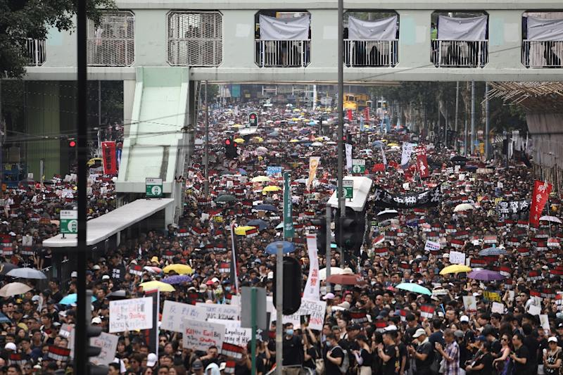 Crowds of black-clad protesters were mraching from a park on the main island to the city's parliament -- a repeat of a massive rally a week earlier that organisers said more than a million people attended (AFP Photo/Dale DE LA REY)