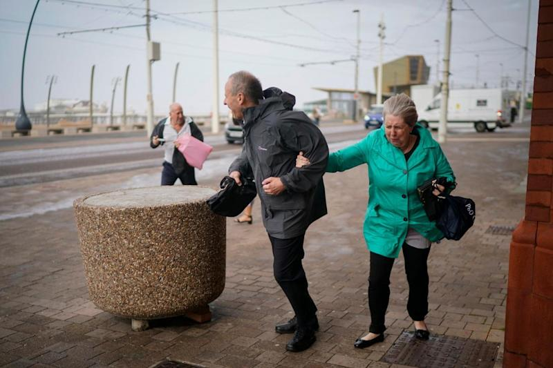 Members of the public struggle in the wind in Blackpool (Getty Images)