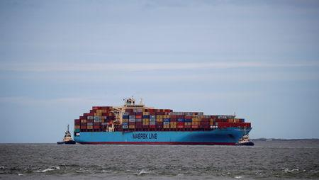 The Maersk Line container ship Maersk Sentosa is helped by tugs as it navigates the River Mersey in Liverpool