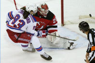 New York Rangers center Mika Zibanejad (93) scores behind New Jersey Devils goaltender Mackenzie Blackwood (29) as an official looks into the net during the first period of an NHL hockey game, Tuesday, April 13, 2021, in Newark, N.J. (AP Photo/Kathy Willens)