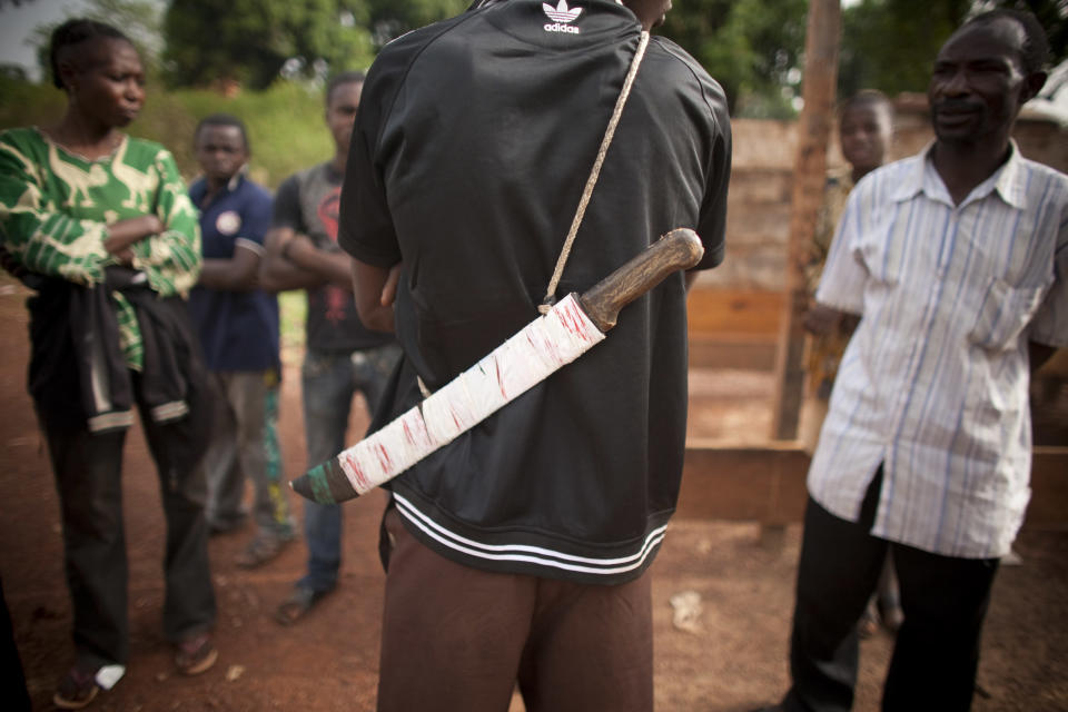 Picture released by Caritas International shows an anti-balaka militia member with his machete in Bossembele, Central African Republic on March 5, 2014 (AFP Photo/Matthieu Alexandre)