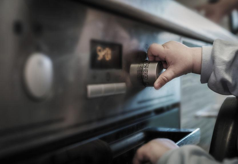 child playing with home oven