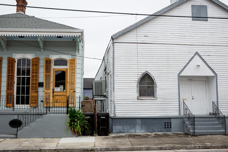 One of Treme's whole-home rentals (left) stands next to a neighborhood church.