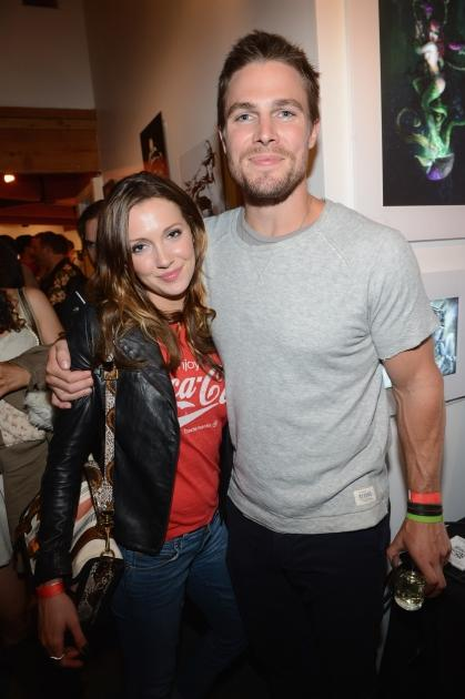 Stephen Amell (R) and Katie Cassidy attend DC Entertainment hosts 'Darkness & Light' party at San Diego Comic-Con International benefitting We Can Be Heroes held at Michael J. Wolf Fine Arts Gallery on July 12, 2012 -- Getty Images