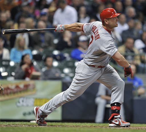 St. Louis Cardinals' Matt Holliday watches his two-run home run against the Milwaukee Brewers during the third inning of a baseball game Friday, May 3, 2013, in Milwaukee. (AP Photo/Jim Prisching)