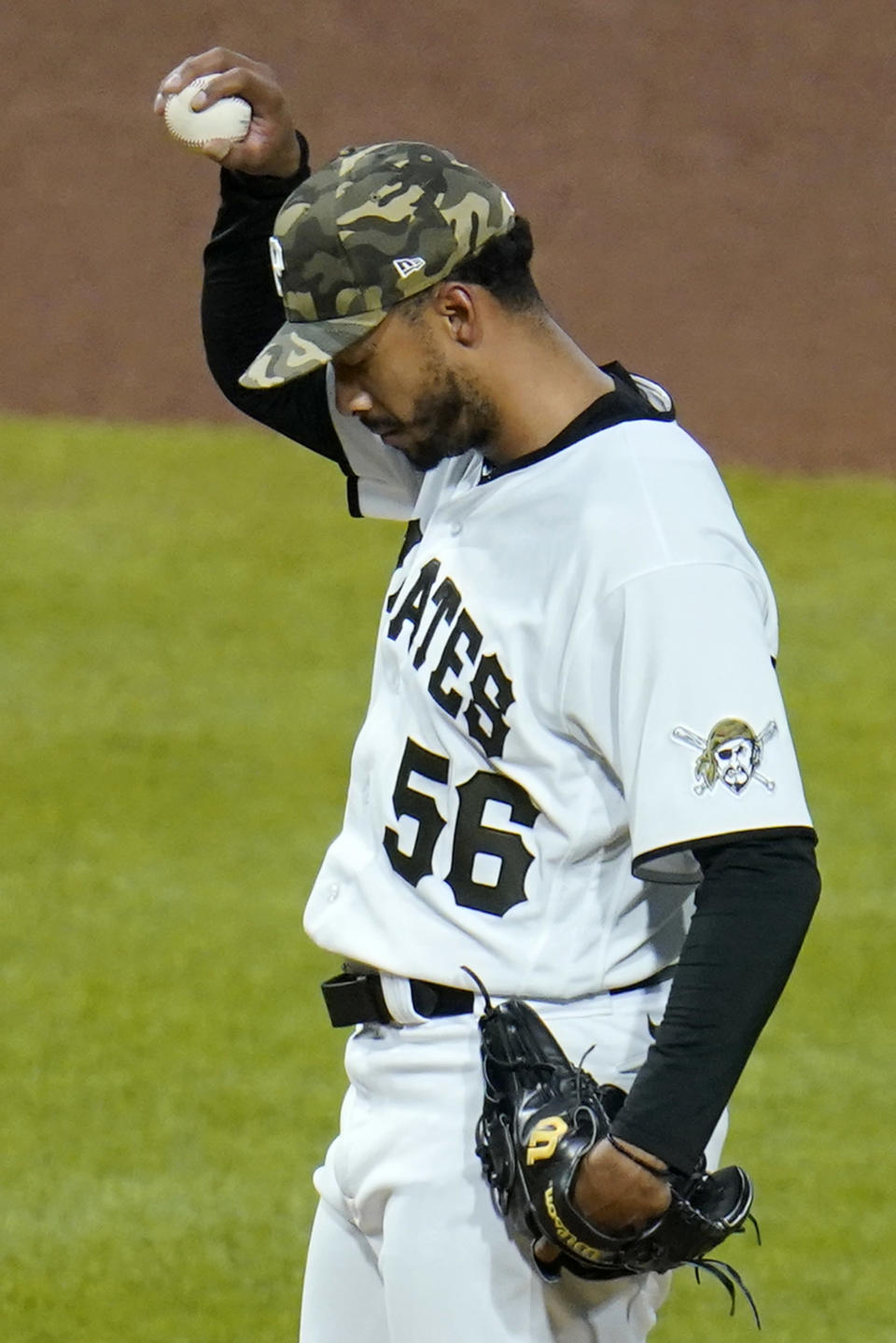 Pittsburgh Pirates relief pitcher Duane Underwood Jr. collects himself after giving up a solo home run to San Francisco Giants' Brandon Crawford during the eighth inning of a baseball game in Pittsburgh, Friday, May 14, 2021. (AP Photo/Gene J. Puskar)