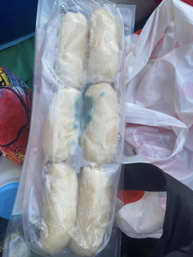 Photo shows a pack of mouldy dinner rolls from Coles.