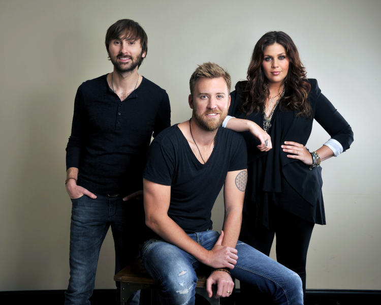 """This March 22, 2013 photo shows members of Lady Antebellum, from left, Dave Haywood, Charles Kelley and Hillary Scott in Nashville, Tenn. Even though a cowboy hat sighting on Fifth Avenue is still pretty rare, country music has made an important move into New York City. Country has its own radio station in the nation's largest market for the first time in 17 years. WNSH-FM, which calls itself """"NASH 94.7,"""" began broadcasting in January and its operators say it has exceeded expectations for its first few months on the air. For country musicians, the news gets a big yee-haw. """"I feel proud for country music,"""" said Dave Haywood of Lady Antebellum. """"It shows that you cannot deny where country music is in today's overall music world."""" (Photo by Donn Jones/Invision/AP)"""