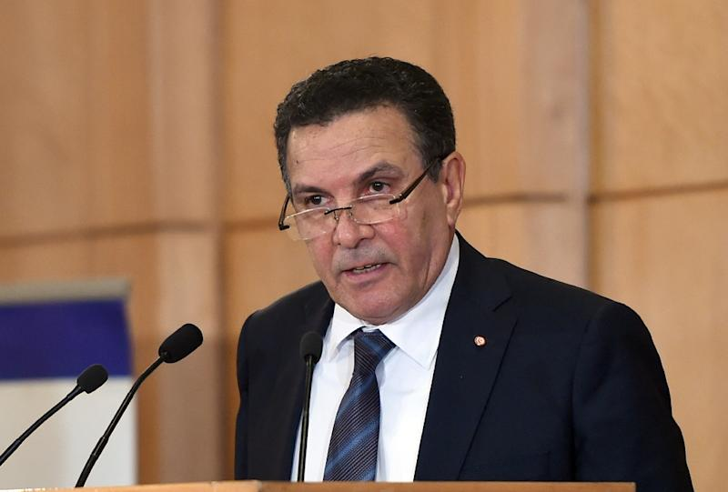 """Tunisian Defence Minister Farhat Horchani delivering a speech during the opening of The Fourth Arab Forum on Asset Recovery """"AFAR """", in the Tunisian city of Hammamet on December 9, 2015"""