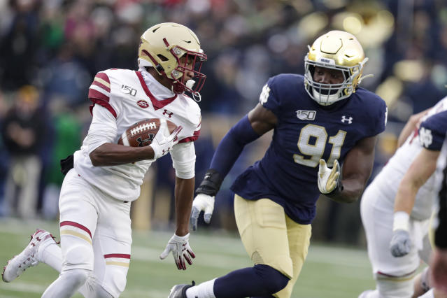 Boston College wide receiver Zay Flowers (4) cuts around Notre Dame defensive lineman Adetokunbo Ogundeji (91) during the first half of an NCAA college football game in South Bend, Ind., Saturday, Nov. 23, 2019. (AP Photo/Michael Conroy)