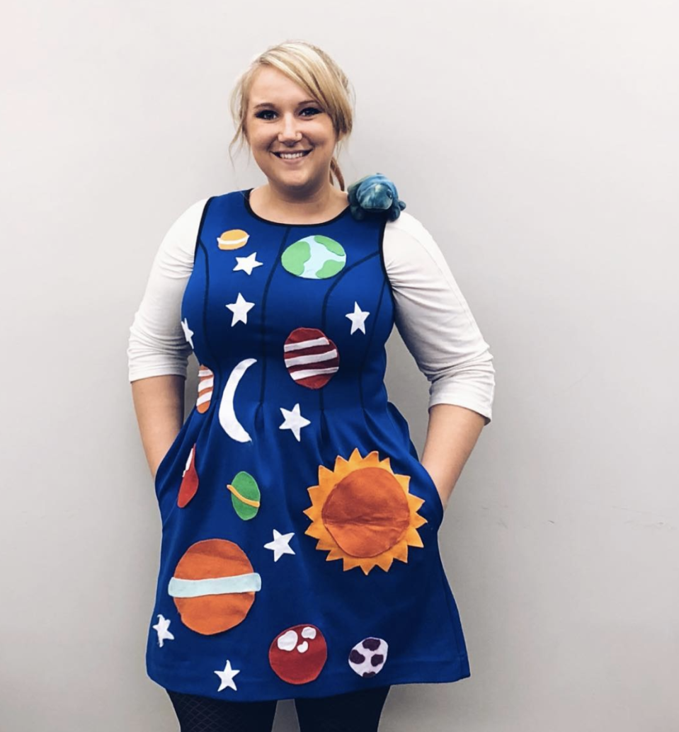 """<p>To dress as everyone's favorite quirky teacher, simply attach felt planets to a blue dress. Bonus points for adding a fiery orange wig. </p><p><a class=""""link rapid-noclick-resp"""" href=""""https://www.instagram.com/p/Bpmp9G0A60G/"""" rel=""""nofollow noopener"""" target=""""_blank"""" data-ylk=""""slk:SEE MORE"""">SEE MORE</a></p><p><a class=""""link rapid-noclick-resp"""" href=""""https://www.amazon.com/Andromeda-Resistant-Synthetic-African-American/dp/B07VK2T4WK/?tag=syn-yahoo-20&ascsubtag=%5Bartid%7C10072.g.33547559%5Bsrc%7Cyahoo-us"""" rel=""""nofollow noopener"""" target=""""_blank"""" data-ylk=""""slk:SHOP WIG"""">SHOP WIG</a></p>"""