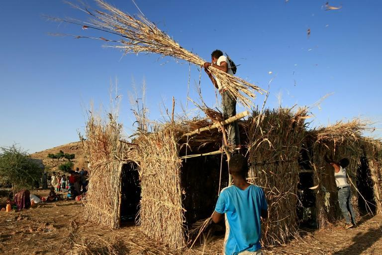 Ethiopian refugees build a house in the Um Raquba camp in Sudan, some of the more than 36,000 Ethiopians who have fled fighting in the northern Tigray region