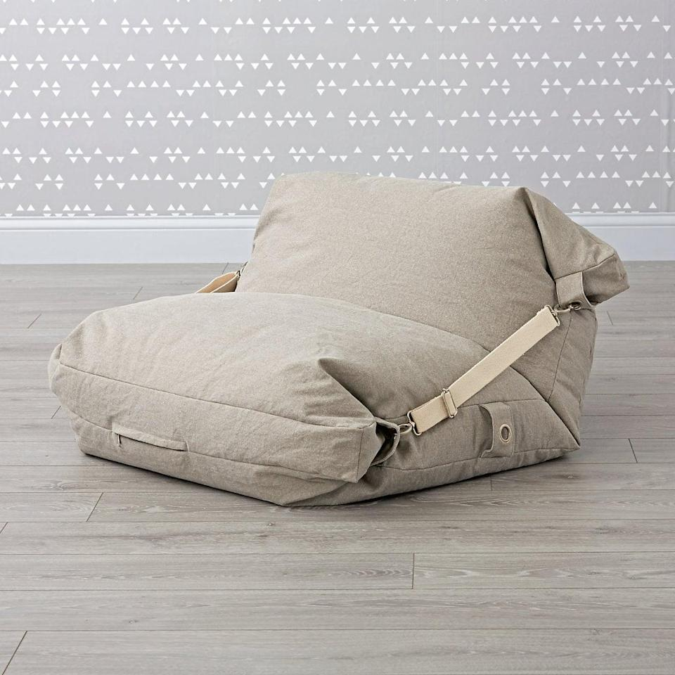 <p><span>Crate & Barrel's Adjustable Bean Bag Chair</span> ($149) is available in three colors and can be laid flat thanks to a pair of helpful straps.</p>