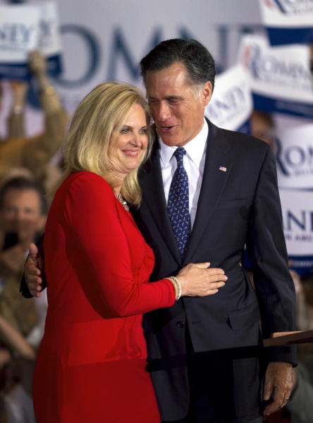 """FILE - In this March 20, 2012 file photo, Republican presidential candidate, former Massachusetts Gov. Mitt Romney, and his wife Ann hug during a victory rally in Schaumburg, Ill. Ann Romney is firing back at a Democratic consultant who is suggesting that the wife of wealthy presidential candidate Mitt shouldn't be talking about the economy's toll on women. """"Guess what, his wife has actually never worked a day in her life,"""" said consultant Hilary Rosen on CNN. The remark inspired Ann Romney's debut on Twitter. (AP Photo/Steven Senne)"""