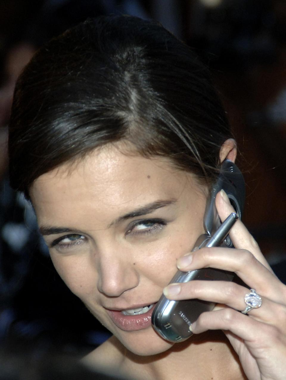 <p>Tom Cruise splashed out on Katie, giving her a 5-carat, £1.2 million diamond ring. <i>[Photo: Getty]</i> </p>