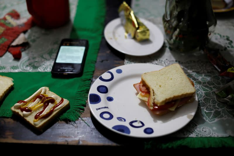 The sandwich of Anthony Vazquez from Venezuela is seen on a table in his relative house in Bogota