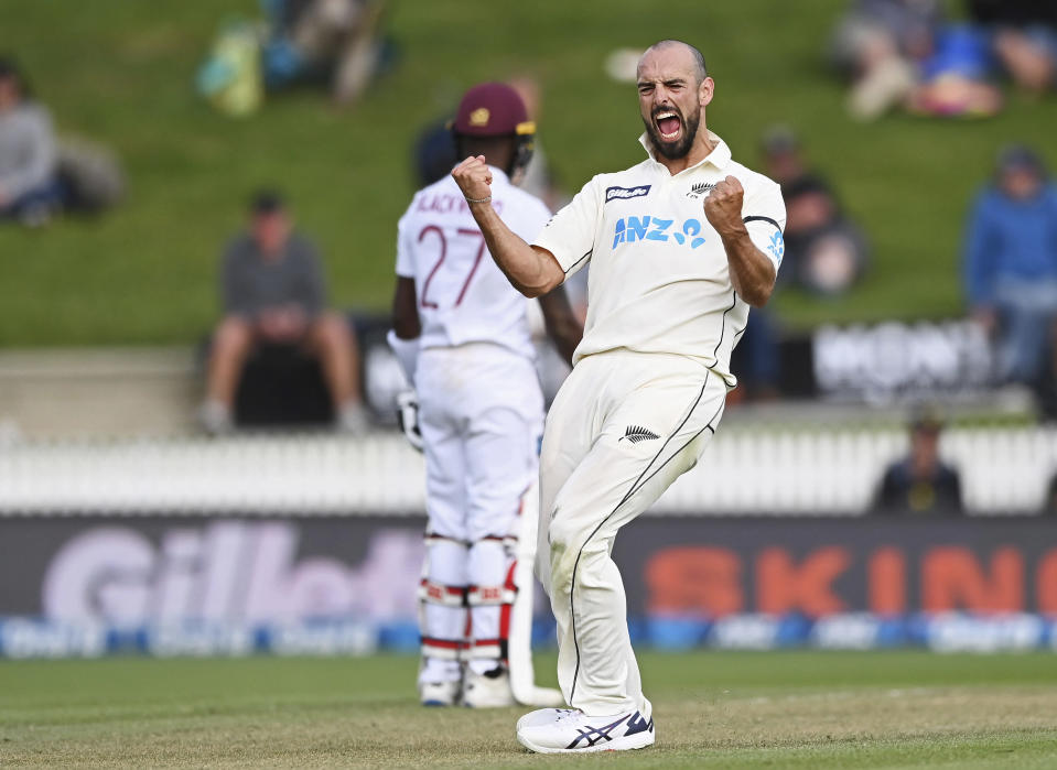 New Zealand's Daryl Mitchell celebrates the wicket of the West Indies' Jason Holder during play on day three of their first cricket test in Hamilton, New Zealand, Saturday, Dec. 5, 2020. (Andrew Cornaga/Photosport via AP)