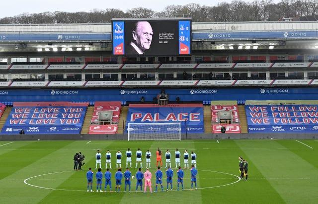 Crystal Palace and Chelsea players stand for a two minute silence prior to kick-off