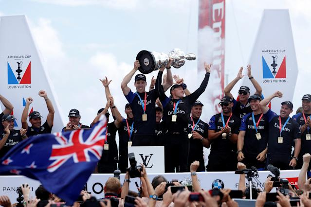 Sailing - America's Cup finals - Hamilton, Bermuda - June 26, 2017 - Peter Burling, Emirates Team New Zealand Helmsman celebrates with Skipper Glenn Ashby as they hold the America's Cup trophy after defeating Oracle Team USA. . REUTERS/Mike Segar