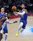 Denver Nuggets guard Markus Howard (00) makes a layup next to Detroit Pistons forward Tyler Cook (25) during the first half of an NBA basketball game, Friday, May 14, 2021, in Detroit. (AP Photo/Carlos Osorio)
