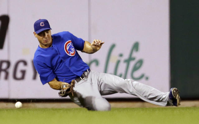 Chicago Cubs left fielder Brian Bogusevic misses a ball hit for a single by St. Louis Cardinals' Matt Holliday during the first inning of a baseball game Friday, Sept. 27, 2013, in St. Louis. (AP Photo/Jeff Roberson)