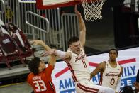 Illinois's Coleman Hawkins fouls Wisconsin's Micah Potter during the first half of an NCAA college basketball game Saturday, Feb. 27, 2021, in Madison, Wis. (AP Photo/Morry Gash)