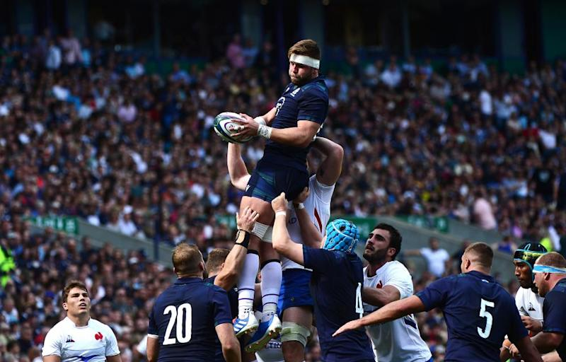 Ryan Wilson of Scotland takes the ball from a line-out.