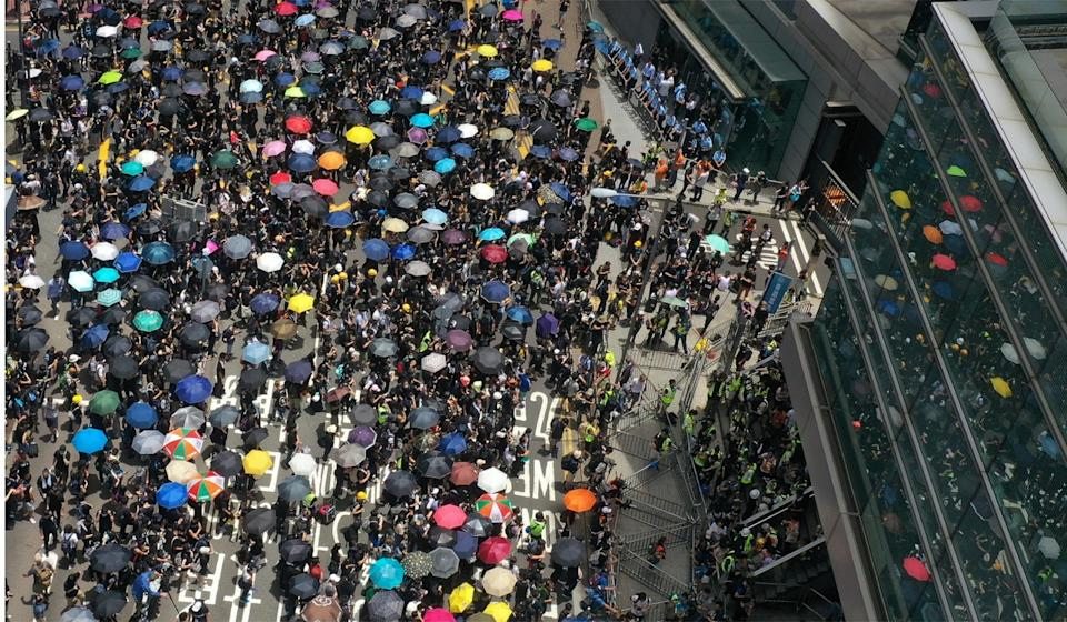 Protesters besiege police headquarters in Wan Chai on Friday. Photo: Martin Chan